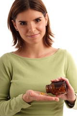 stock photo of young woman taking pills