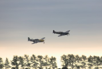 spitfire and mustang at sunset