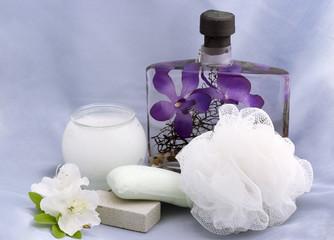 bath essentials with azalea flowers