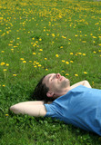 young man lying on the grass poster