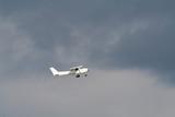 private plane on a strormy sky poster