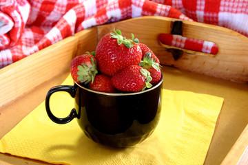 strawberries in black cup