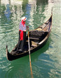 gondola and gondolier on the water
