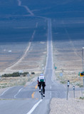lonely bicyclist going across country poster