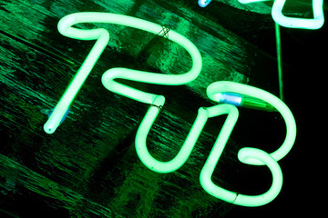 green neon sign pub