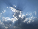 white clouds and sun beams poster