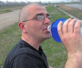 man drinking poster