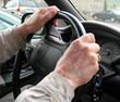 elderly hands on steering wheel