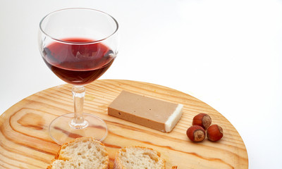 pate, bread, glass of red wine, hazelnuts on wood