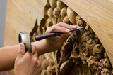 hands engraving wood poster