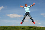 man jumping against blue sky poster