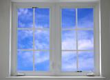 Fototapeta Okno z błękitnym niebiem