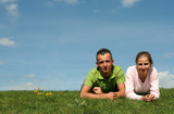 couple lying on the grass poster