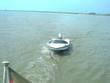 sportboot auf der ems im schlepp