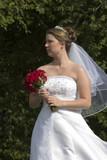bride holding bouquet poster