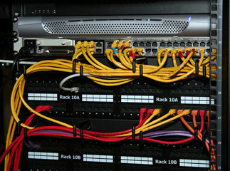 network cables plugged into patch panels