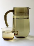 grey glass pitcher and glass and water poster