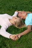 couple lying on grass poster