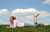 girl lying on grass poster