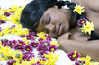 sleeping beauty in a bed of flowers
