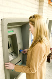 woman using atm poster