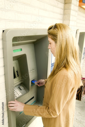 poster of woman using atm