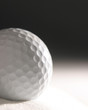 golf ball in sand dune