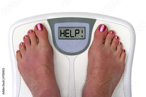 feet on a bathroom scale - isolated - 700433
