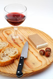 pate, bread, glass of red wine, hazelnuts and knif