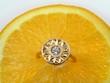 orange background and diamond ring