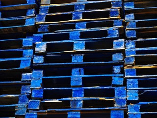 bright blue wooden shipping palettes