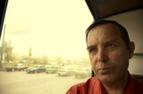 serious man in trolleybus(special warm fx,focus point on the lef poster