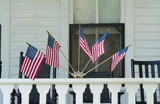 cape may bed and breakfast with flags on porch poster