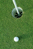 golf ball near hole poster