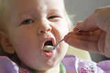 child eating pap poster