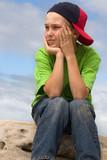 child in cap looking sideways poster