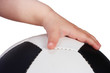 baby hand hold soccer ball