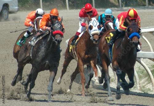 Leinwanddruck Bild race horses turning into the stretch