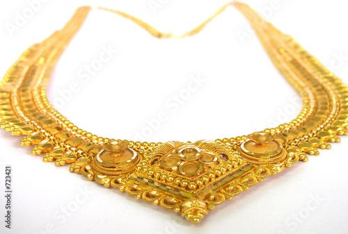 poster of gold necklace