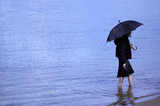 girl with umbrella on the blue water background poster