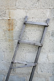 ladder against brick wall poster