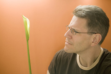 man contemplates a calla lily
