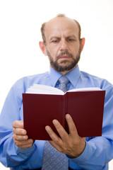 senior businessman reading a book