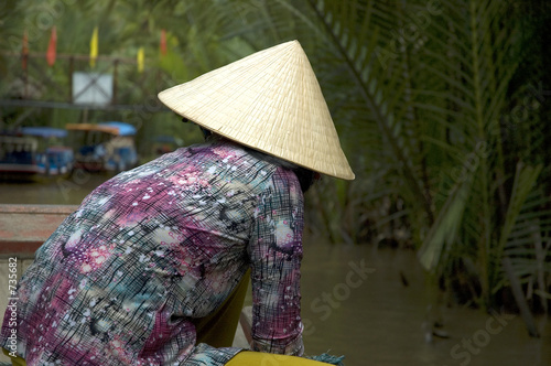 vietnamese woman operating a boat