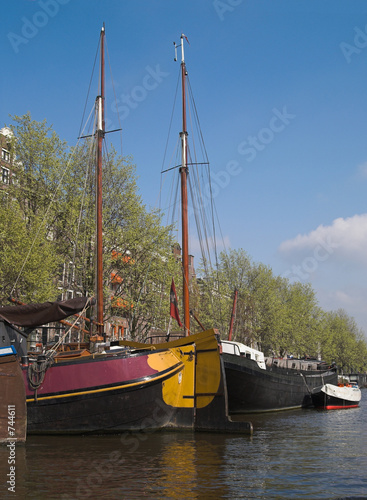 yachts in city canal, amsterdam, netherlands