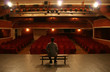 man alone on theater scene