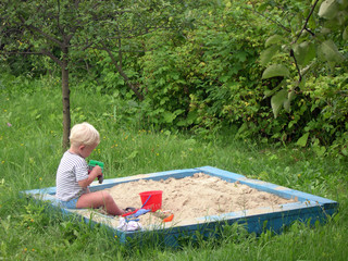 kid in playpit