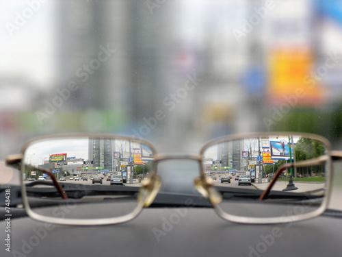 Leinwanddruck Bild glasses on front panels of car