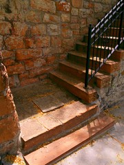 stone stairway partially in strong sunlight