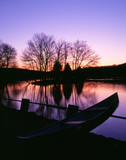 moored canoe by a twilight lake poster